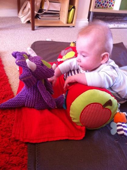 Baby meets dinosaur