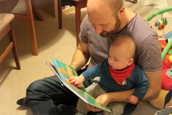 Daddy and baby reading