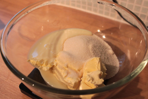 cream together butter, sugar and condensed milk