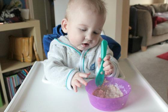 Baby eating porridge - first food