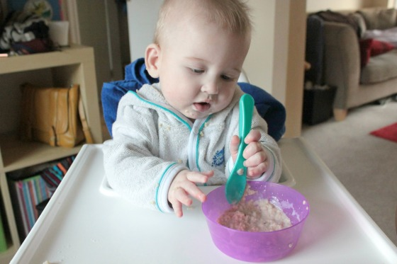 Baby eating porridge - first food